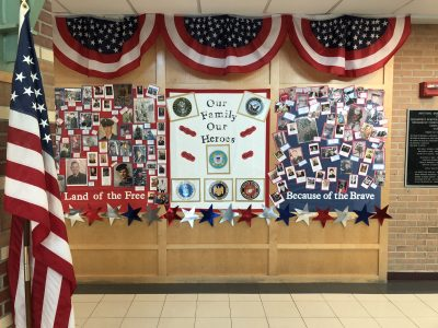 PTO created a bulletin board displaying photos of veterans related to our students.